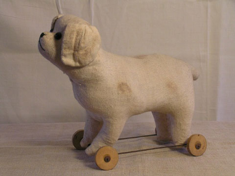 Old Flannel-covered Cloth Dog on Wheels